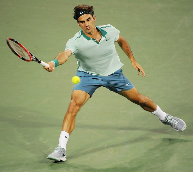 Roger Federer of Switzerland returns