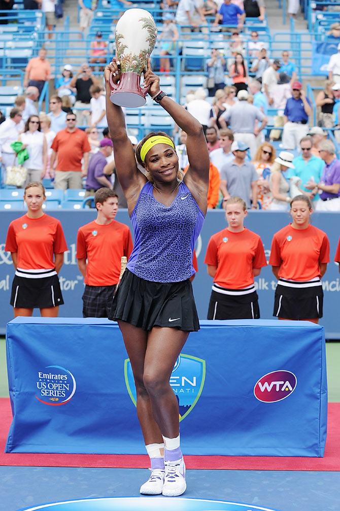 Serena Williams poses with the winner's trophy after Cincinnati final on Sunday