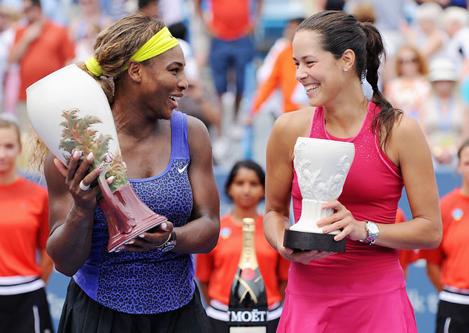 Serena Williams and Ana Ivanovic of Serbia pose with their trophies after the final at Cincinnati on Sunday