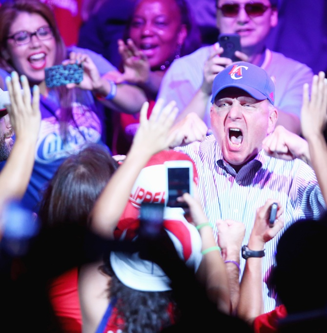 New owner of the Los Angeles Clippers Steve Ballmer reacts to the fans after being   introduced for the first time during Los Angeles Clippers Fan Festival at Staples Center