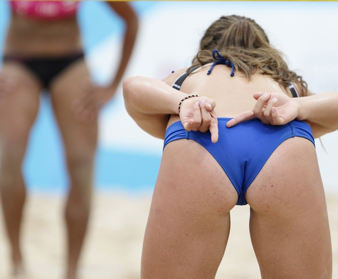 Erika Sofia Mongelos Bobadilla of Paraguay gestures to her teammate during her game against Thailand during the Nanjing 2014 Youth Olympic Beach Volleyball at the Olympic Sports Park
