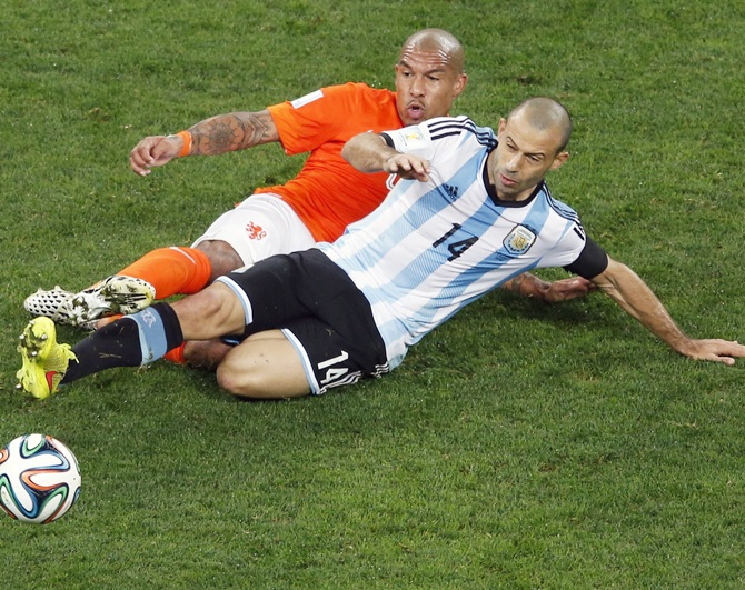 Nigel de Jong of the Netherlands, left, and Argentina's Javier Mascherano fight for the ball