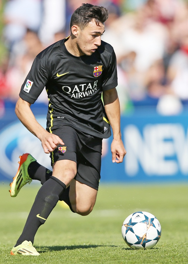 Munir El Haddadi of FC Barcelona runs with the ball