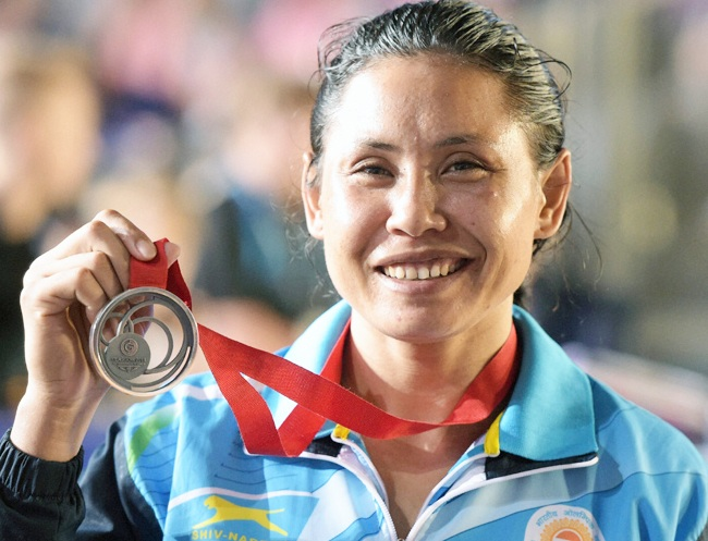 Sarita Devi with her 2014 Commonwealth medal. Photograph: PTI
