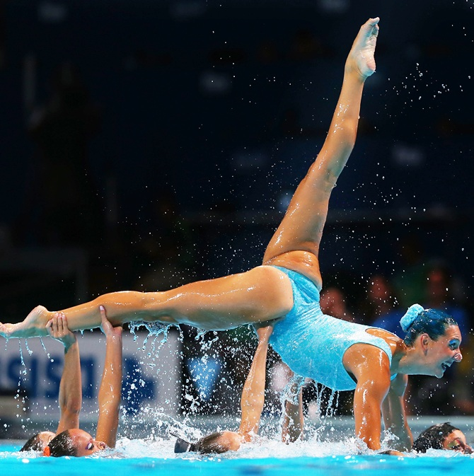 Italy compete during the Synchronized Swimming Free Combination Final