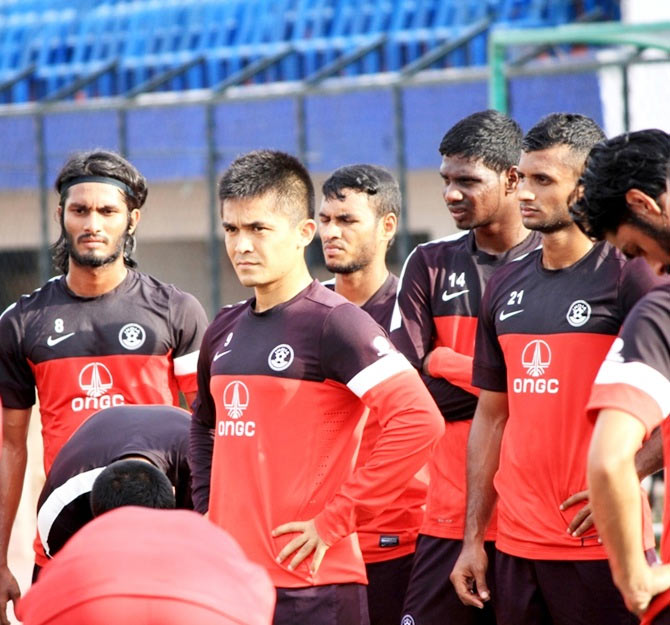 India captain Sunil Chhetri, second left, with teammates