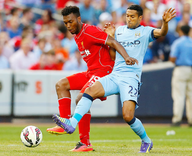 Gael Clichy of Manchester City (right) and Daniel Sturridge of Liverpool vie for the ball