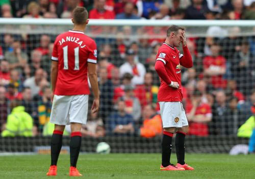 Wayne Rooney of Manchester United looks dejected during the Barclays Premier League match between Manchester United and Swansea City
