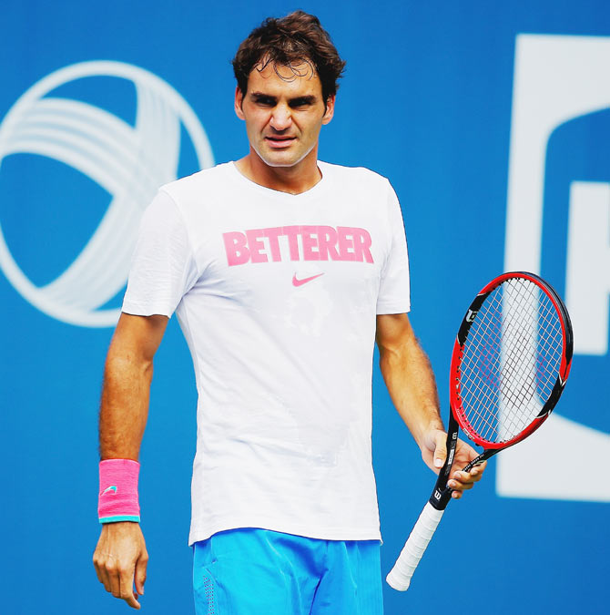 Roger Federer of Switzerland looks on during practice prior to the start of the 2014 U.S. Open at the USTA Billie Jean King National Tennis Center in New York City on Thursday