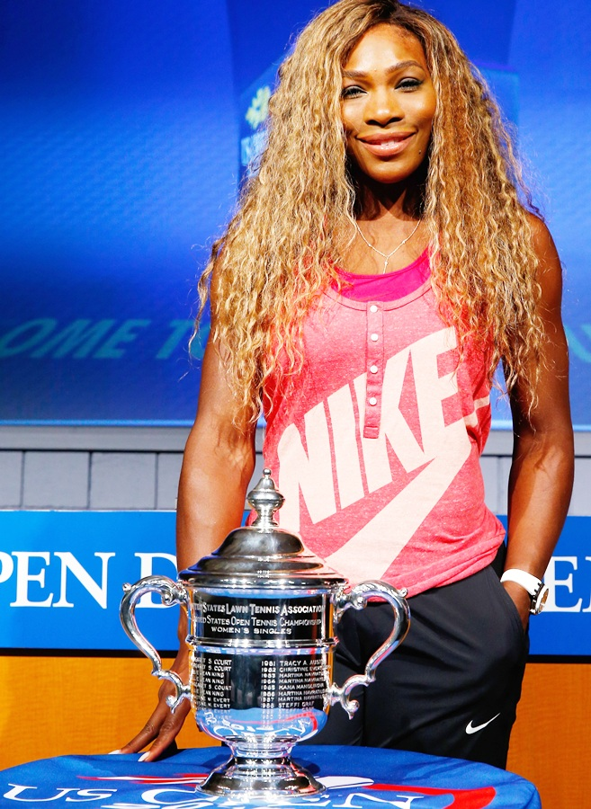 Serena Williams of the United States smiles alongside the Women's Singles US Open trophy