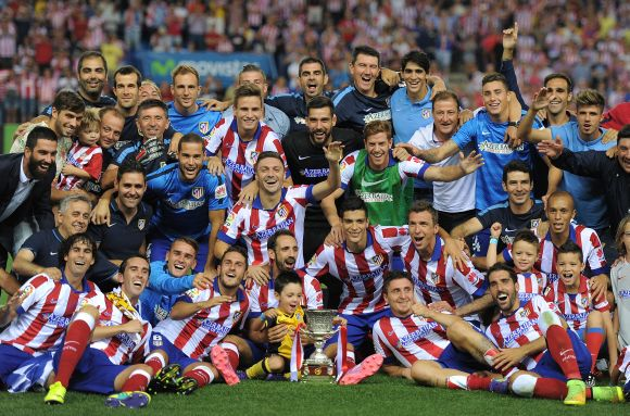 Club Atletico de Madrid players celebrate after beating Real Madrid on aggregate to win the Spanish Supercopa