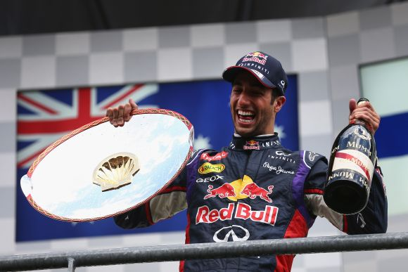 Daniel Ricciardo of Australia and Infiniti Red Bull Racing celebrates on the podium after winning the Belgian Grand Prix
