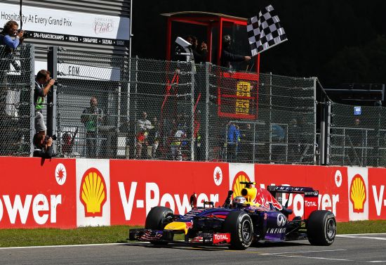 Red Bull Formula One driver Daniel Ricciardo of Australia crosses the finish line to win the Belgian F1 Grand Prix in Spa-Francorchamps