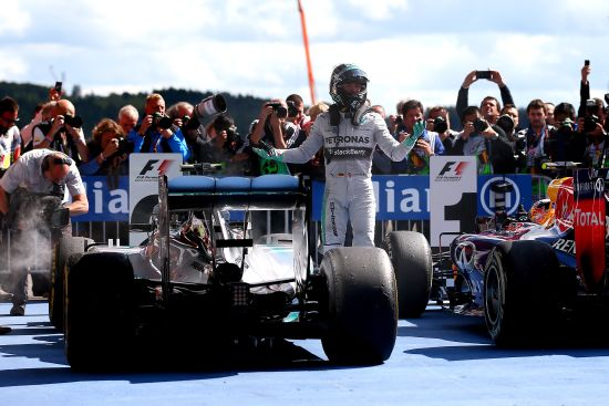 Nico Rosberg of Germany and Mercedes GP reacts as he gets out of his car in Parc Ferme