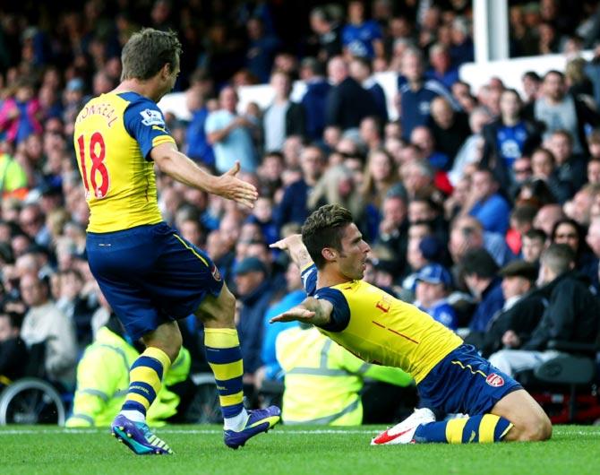 Olivier Giroud (right) celebrates scoring Arsenal's second goal
