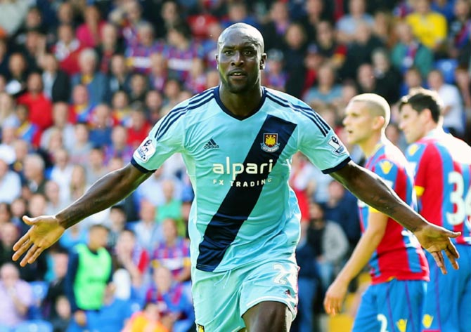 Carlton Cole of West Ham celebrates scoring his team's third goal