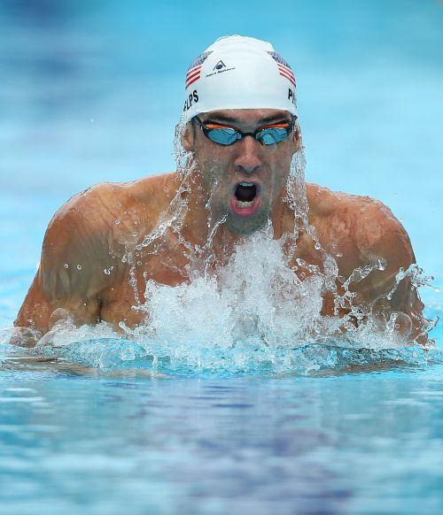 Michael Phelps of the USA swims the Men's 200m IM heats