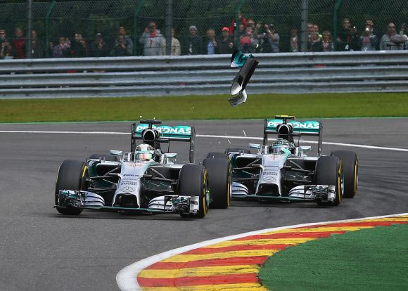 Debris flies in the air as Nico Rosberg of Germany and Mercedes GP makes contact with Lewis Hamilton of Great Britain and Mercedes GP during their race on Sunday