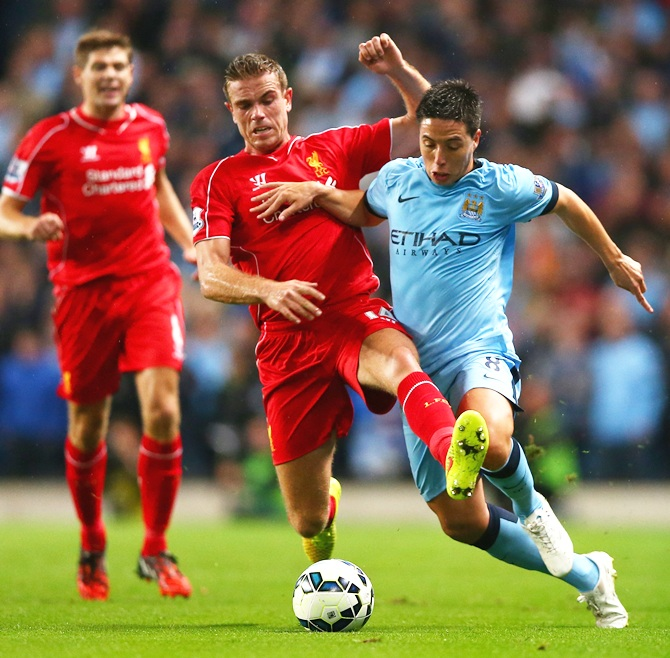 Jordan Henderson of Liverpool battles with Samir Nasri of Manchester City