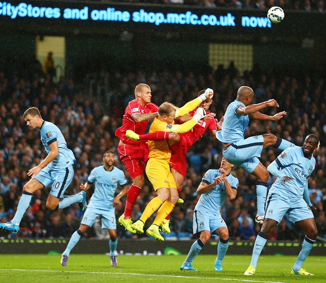 Joe Hart of Manchester City punches clear under pressure