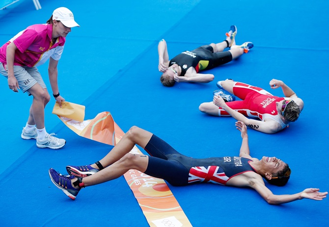 Ben Dijkstra of Great Britain, front, celebrates with the other athletes after crossing the finish line in the Men's Triathlon on Day two of Nanjing 2014 Summer Youth Olympic Games