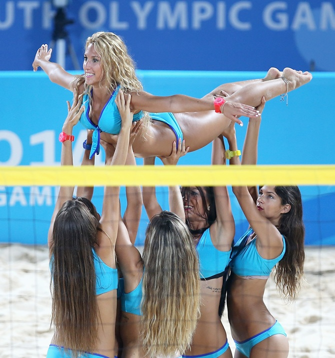 Dancers perform during the Nanjing 2014 Youth Olympic Beach Volleyball at the Olympic Sports Park