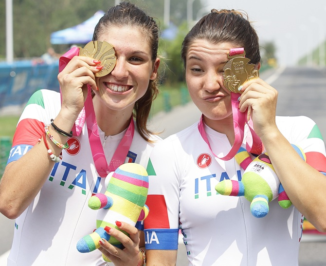 From left, Sofia Beggin and Chiara Teocchi of Italy win the gold medal in the cycling Women's Team Event