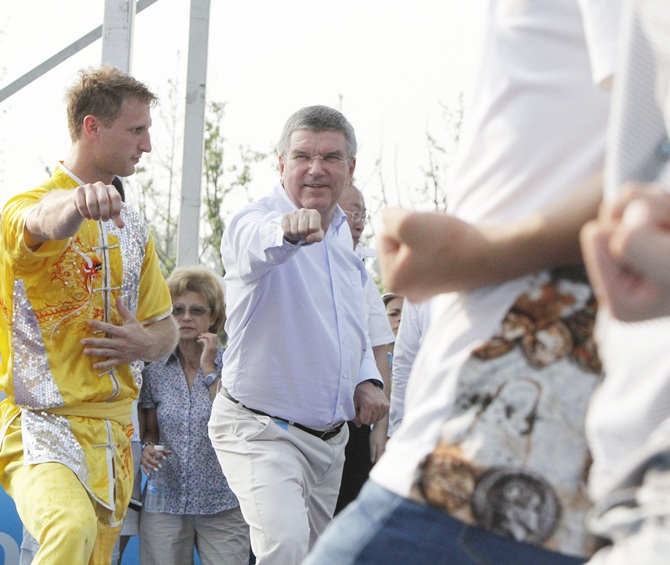 IOC President Thomas Bach visits the Nanjing 2014 Sports Lab, which includes four   non-Olympic sports: Rock Climbing, Roller Skating, Skateboarding and Wushu