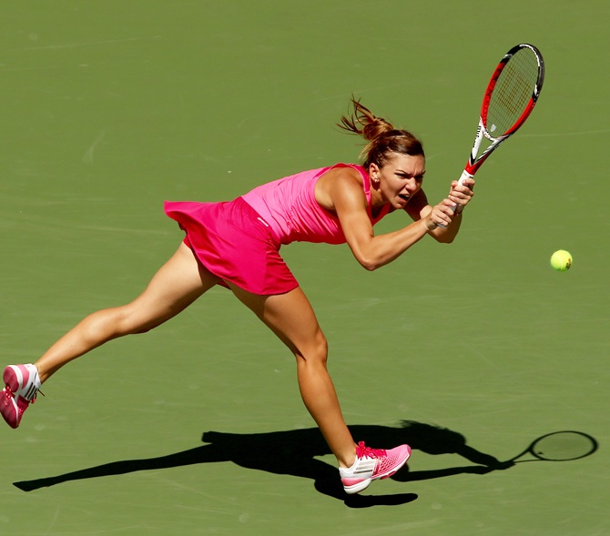 Simona Halep of Romania returns a shot to Danielle Rose Collins of the United States