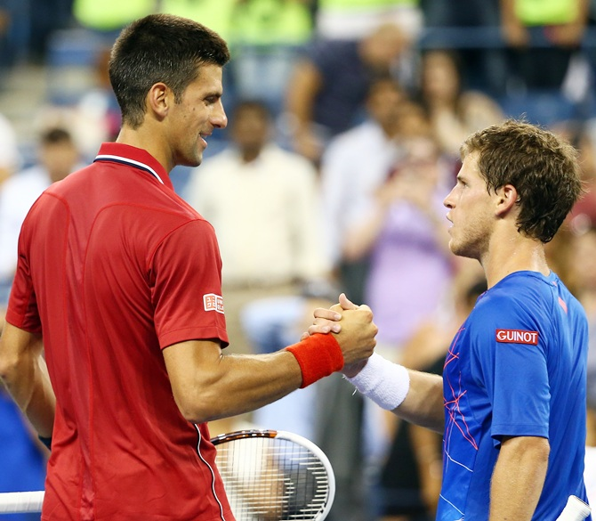 Novak Djokovic of Serbia greets Diego Schwartzman of Argentina after their men's singles first round match