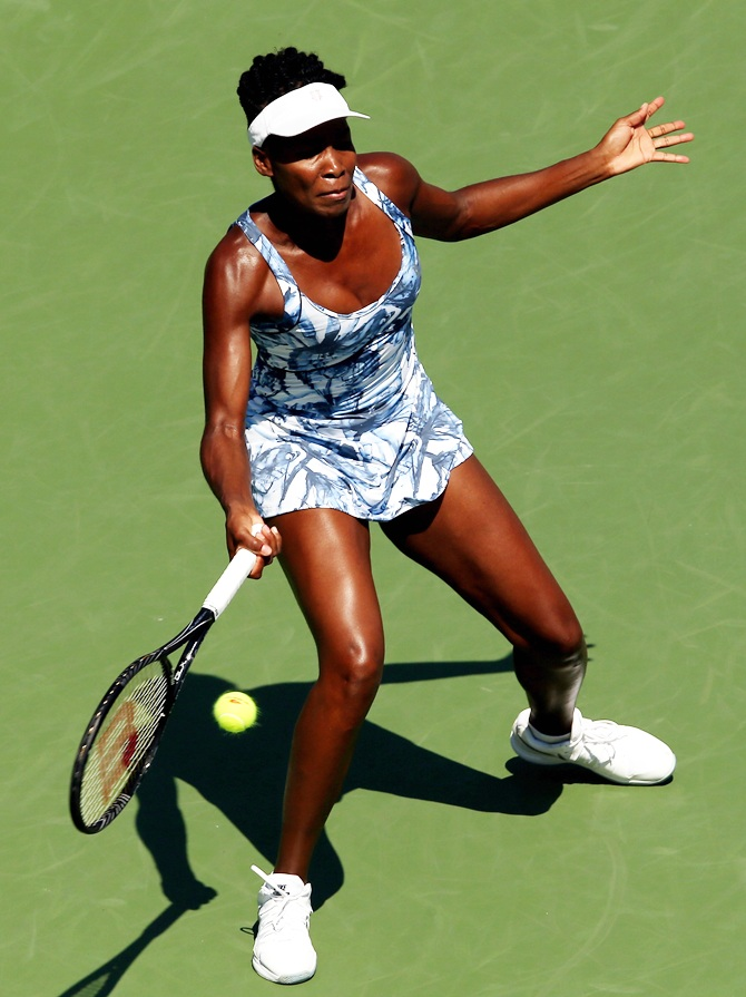 Venus Williams of the United States returns a shot against Kimiko Date-Krumm of Japan