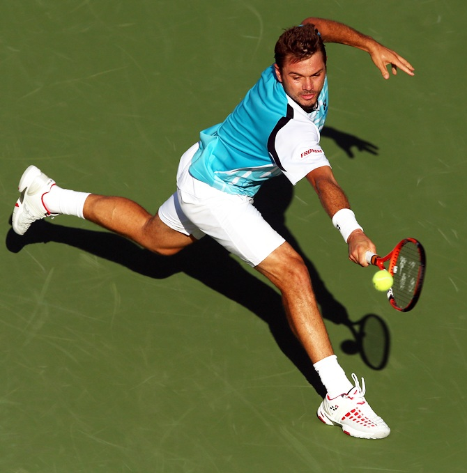Stanislas Wawrinka of Switzerland returns a shot against Jiri Vesely of the Czech Republic