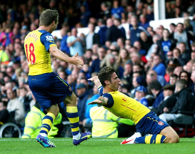 Olivier Giroud (right) celebrates scoring Arsenal's second goal