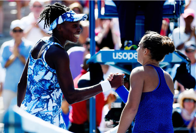 Venus Williams of the United States greets Sara Errani of Italy after losing in their women's singles third round match