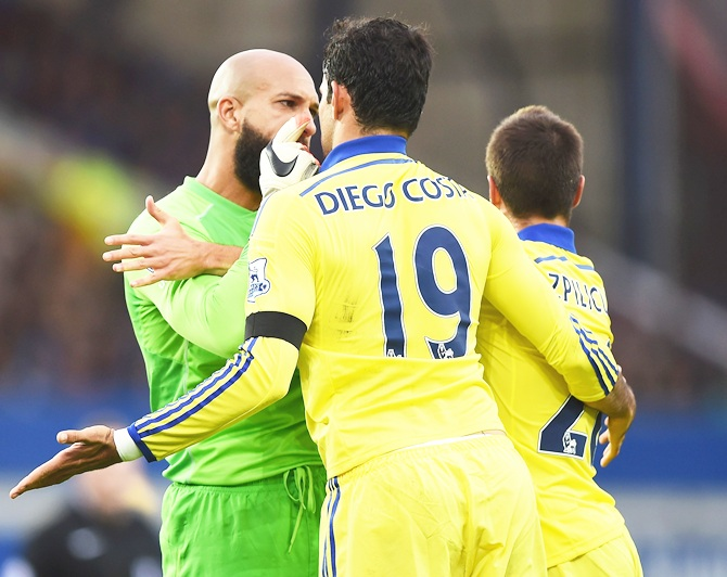 Tim Howard of Everton confronts Diego Costa of Chelsea