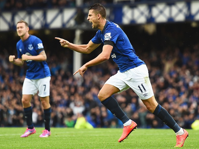 Kevin Mirallas of Everton celebrates scoring his goal