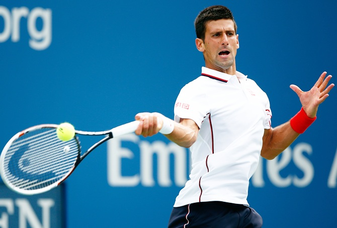 Novak Djokovic of Serbia returns a shot
