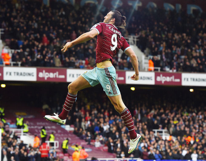 Andy Carroll of West Ham celebrates scoring their second goal during the Barclays Premier League match between West Ham United and Swansea City at Boleyn Ground in London on Sunday