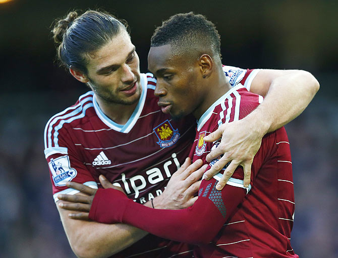 Diafra Sakho (right) of West Ham United celebrates with Andy Carroll after scoring his team's third goal against Swansea City