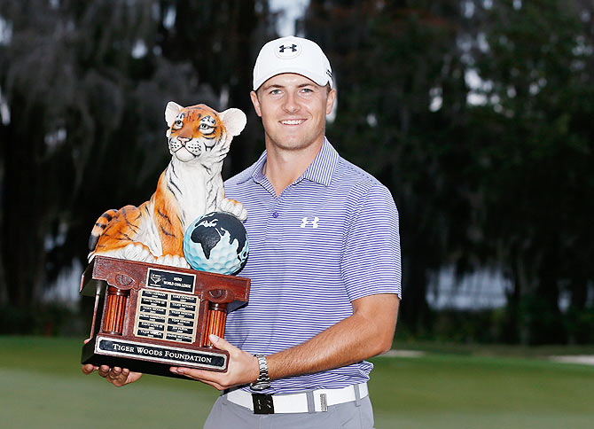 Jordan Spieth with the winner's trophy after his ten-stroke victory at the Hero World Challenge at the Isleworth Golf & Country Club in Windermere, Florida, on Sunday