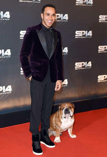 Lewis Hamilton and his dog Roscoe attend the BBC Sports Personality of the Year awards at The Hydro in Glasgow, Scotland, on Sunday