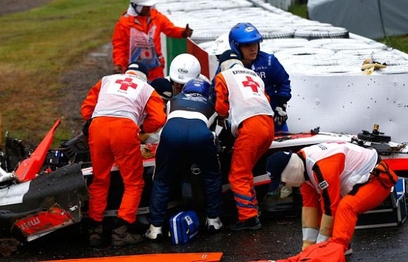 Jules Bianchi of France and Marussia receives urgent medical treatment after crashing during the Japanese Formula One Grand Prix at Suzuka Circuit. Photograph: Getty Images