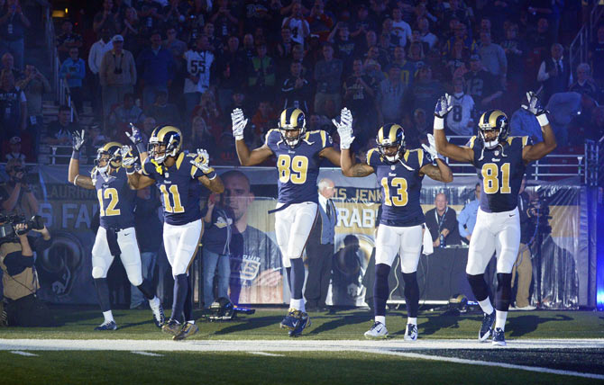 St. Louis Rams Stedman Bailey (12), Tavon Austin (11), Jared Cook (89), Chris Givens (13) and Kenny Britt (81) put their hands up to show support for Michael Brown before a game against the Oakland Raiders at the Edward Jones Dome on November 30