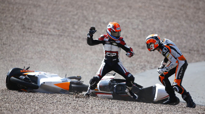 Mahindra Moto3 rider Bryan Schouten of the Netherlands fights with compatriot Kalex KTM Moto3 rider Scott Deroue (right) after they crashed during the German Grand Prix at the Sachsenring circuit in the eastern German town of Hohenstein-Ernstthal on July 13