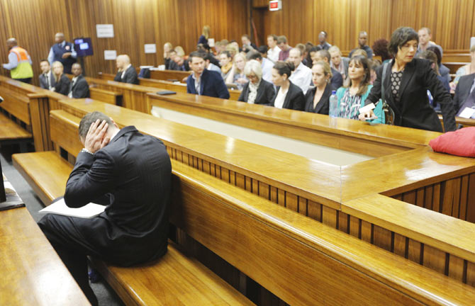 Oscar Pistorius sits in the dock ahead of the second day of the murder trial at the North Gauteng High Court in Pretoria, on March 4. Photograph: Kim Ludbrook/Pool/Reuters