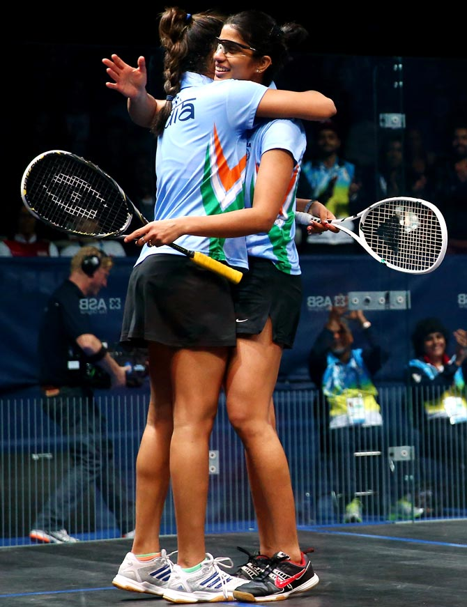 India's Dipika Pallikal (left) and Joshna Chinappa celebrate