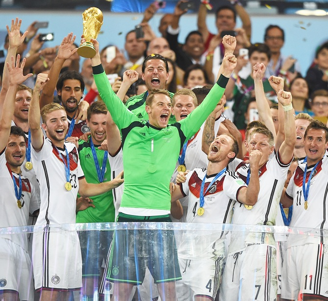 Manuel Neuer of Germany lifts the World Cup trophy with his team after defeating Argentina 1-0