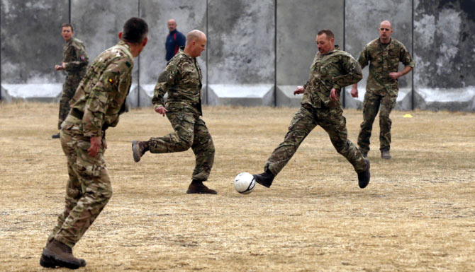 Rediff Sports - Cricket, Indian hockey, Tennis, Football, Chess, Golf - PHOTOS: Soldiers in Afghanistan play soccer in memory of WW1 truce