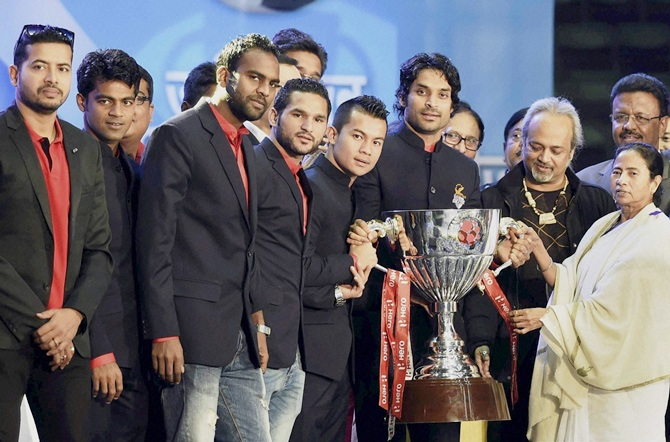 West Bengal Chief Minister Mamata Banerjee with the players of Atletico De Kolkata