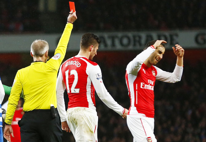 Rediff Sports - Cricket, Indian hockey, Tennis, Football, Chess, Golf - Arsenal forced to sweat after late Olivier twist